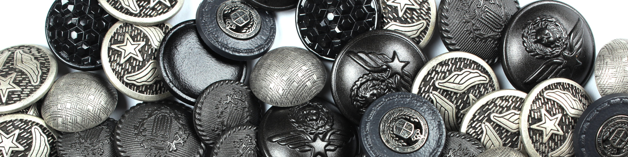 Silver and black buttons